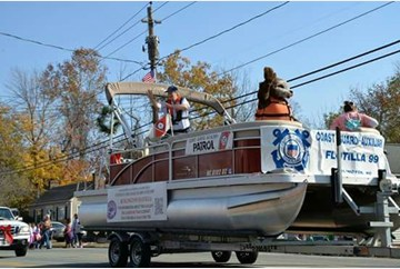 Flotilla 9-9 participating in Burlington Christmas Parade with Sammy the Sea Otter.