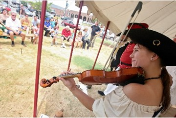 Rachel Green plays with the Chanteymen group Saturday during the Blackbeard Festival in downtown Hampton July 10, 2010. The group performs traditional sea-faring songs.