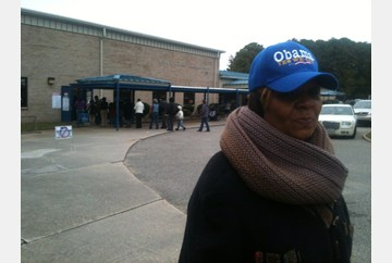 Stachia Richardson, a volunteer for the Obama campaign, stands outside the Saunders polling location in Newport News. Turnout was high, volunteers report.