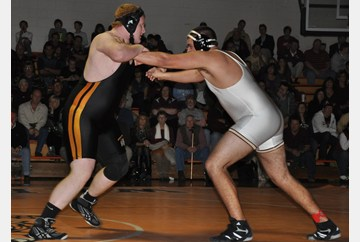 Tabb's Jacob Rose pins Poq heavy weights (285) to keep his undefeated title