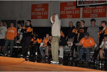 Coach Doug Roper, Tabb, looks on as wrestling gets intense