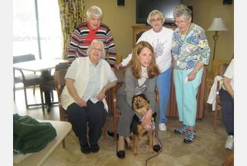 Flower enjoying her visit with the delightful ladies of The Devonshire, for Pet Therapy day !!