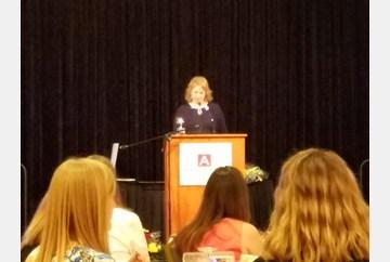 Maria Radwanski accepts the Distinguished Alumni Award