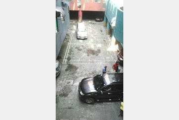 Seemingly making space for a grey car.